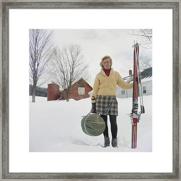 Skiing Waitress Framed Print