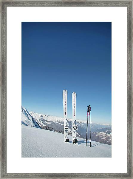 Skis And Ski Poles Stuck In The Snow Framed Print
