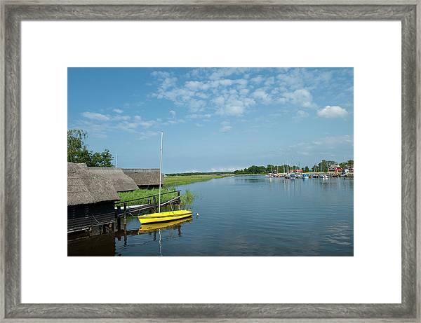 Small Sailboat At Old Boat House Framed Print