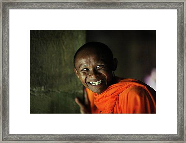 Smiling Buddhist Monk At Angkor Wat Framed Print by Timothy Allen