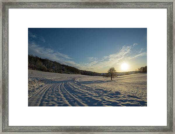 Snow And Sunset Framed Print