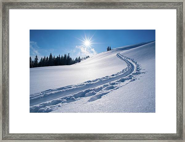 Snow Track Of A Backcountry Skier In Framed Print by Olaf Broders