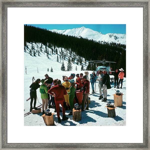 Snowmass Picnic Framed Print by Slim Aarons