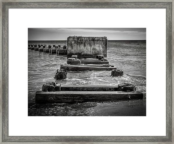 Framed Print featuring the photograph Something In The Water by Steve Stanger