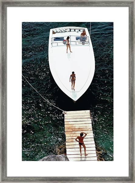 Speedboat Landing Framed Print by Slim Aarons