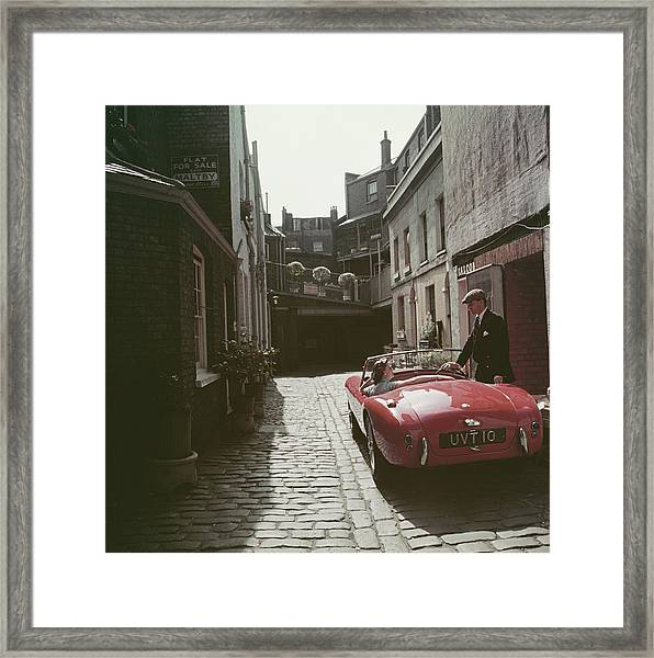 Sports Car Couple Framed Print by Slim Aarons