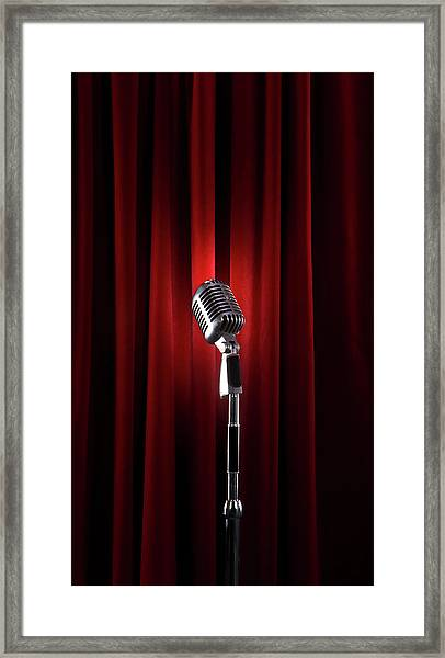 Spotlit Microphone Against Red Velvet Framed Print