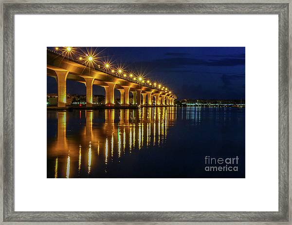 Framed Print featuring the photograph Starburst Bridge Reflection by Tom Claud