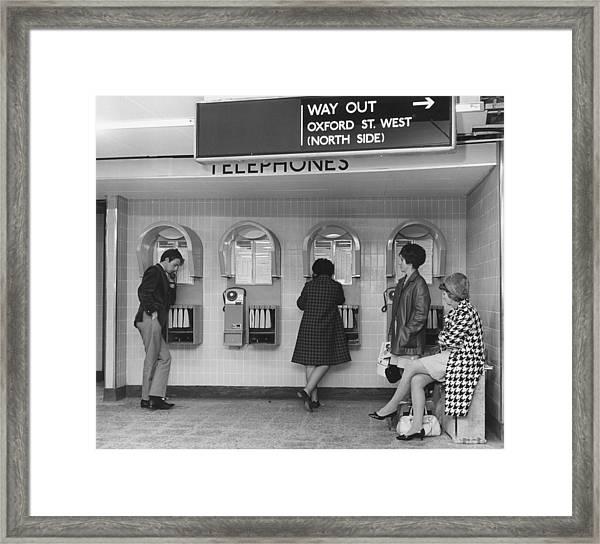 Station Telephones Framed Print
