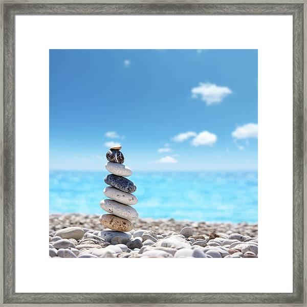 Stone Balance On Beach Framed Print by Imagedepotpro
