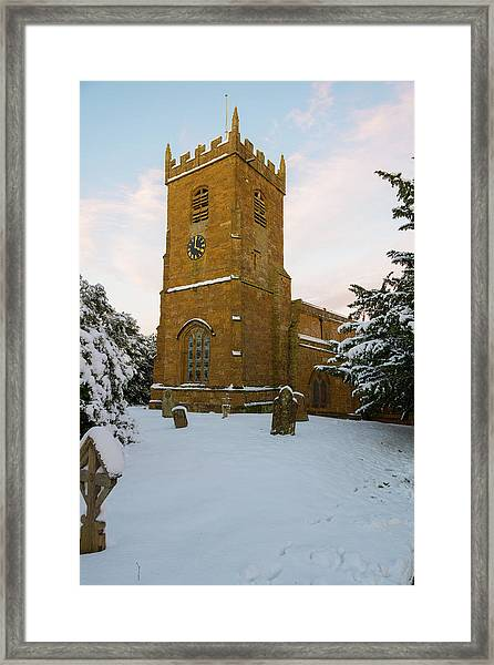 Stone Church In The Snow At Sunset Framed Print