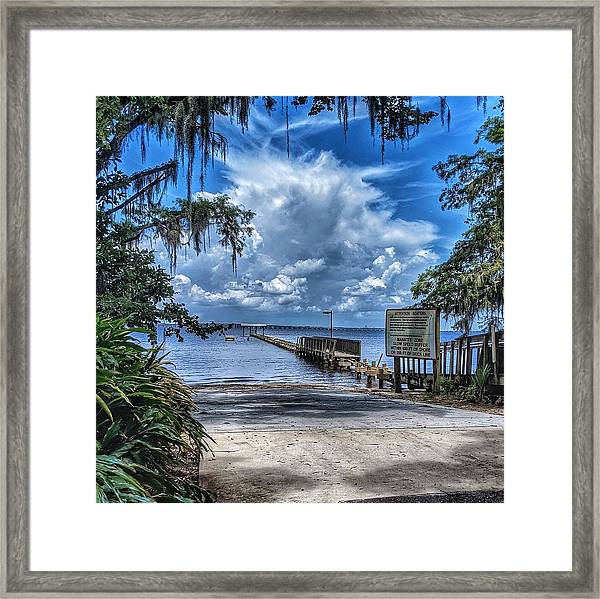 Strolling By The Dock Framed Print