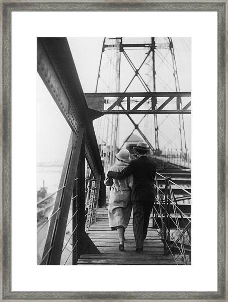Strolling Couple Framed Print by Fpg