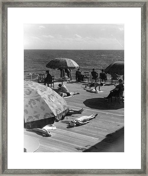 Sun Bathing On Deck Framed Print