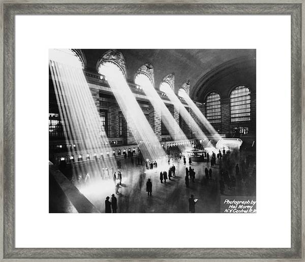 Sun Beams Into Grand Central Station Framed Print by Hal Morey