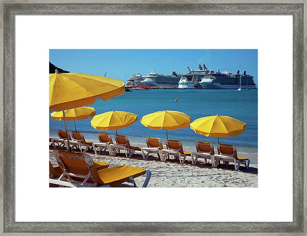 Sun Loungers And Sunshades On The Beach Framed Print