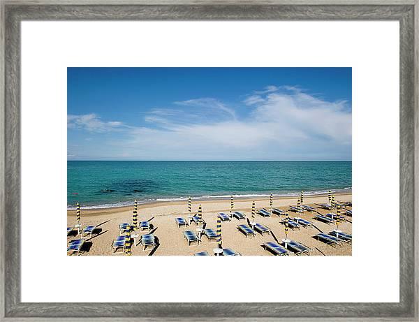 Sun Loungers On The Beach At Sirolo Framed Print