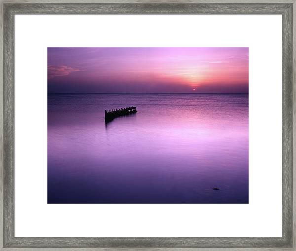 Sun Sets On A Sunken Boat Framed Print