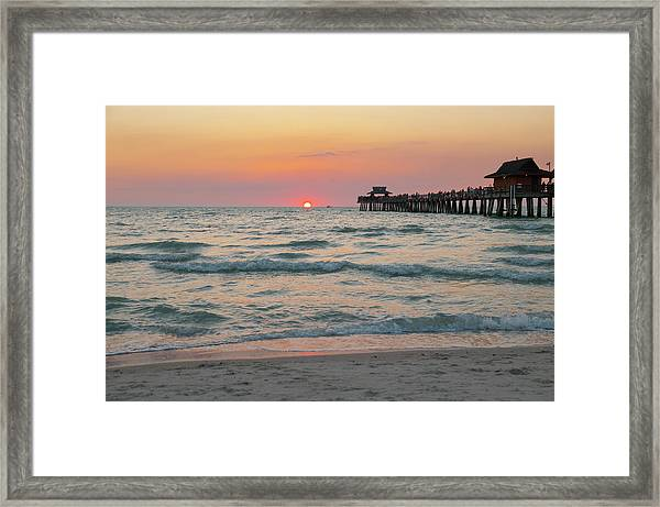 Sun Sinks Below Horizon At Gulf Of Framed Print