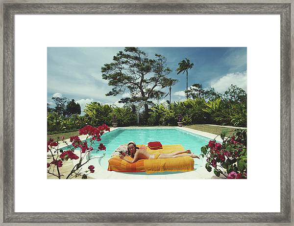 Sunbathing In Barbados Framed Print by Slim Aarons