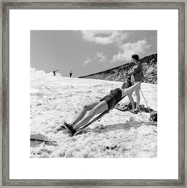 Sunbathing Skier Framed Print by Don