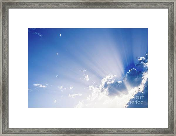 Sunbeams Rising From A Large Cloud In Intense Blue Sky On A Summer Afternoon Framed Print