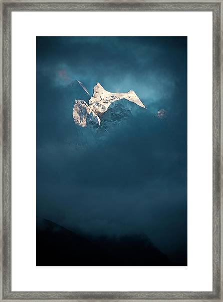 Sunlit Snow Himalaya Peak Dark Swirling Framed Print