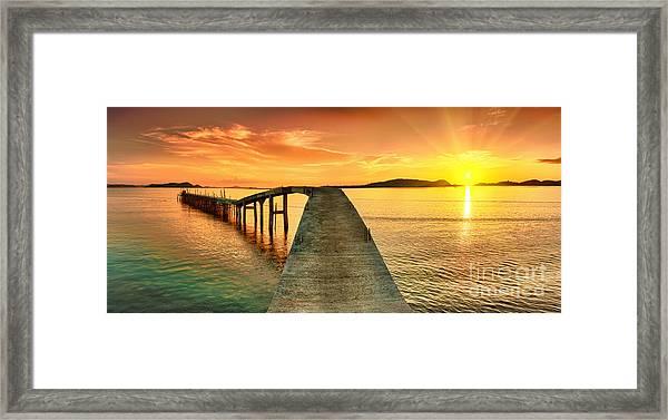 Sunrise Over The Sea. Pier On The Framed Print