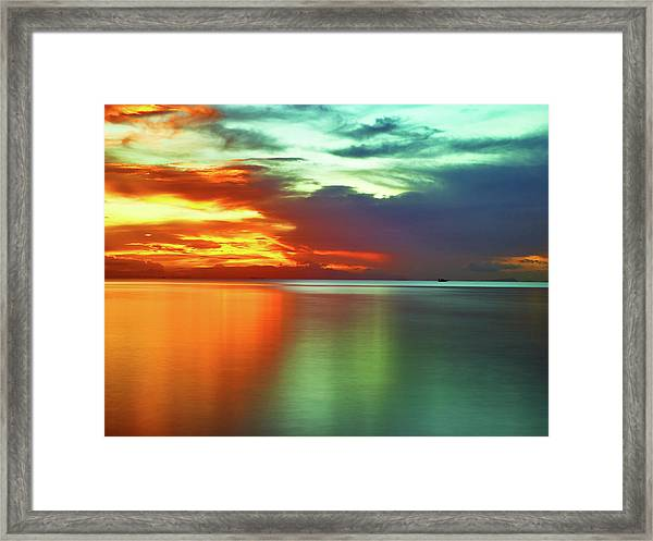Sunset And Boat Framed Print