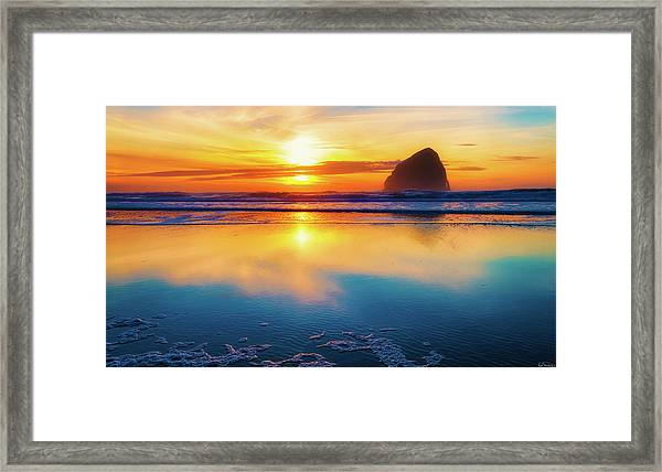 Framed Print featuring the photograph Sunset Haystack Rock by Dee Browning