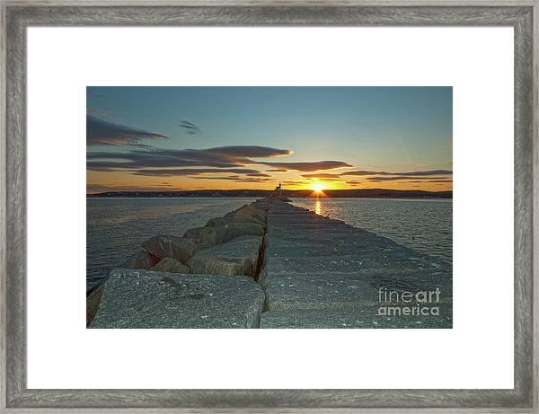Sunset Seawall Framed Print