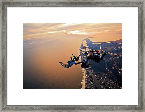 Sunset Skydive Over The Coastline Framed Print