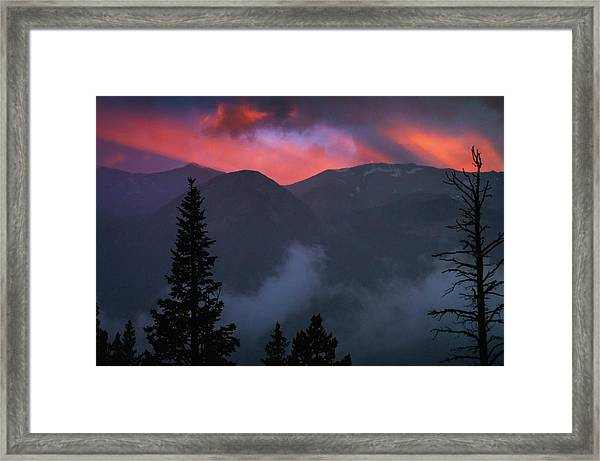 Sunset Storms Over The Rockies Framed Print