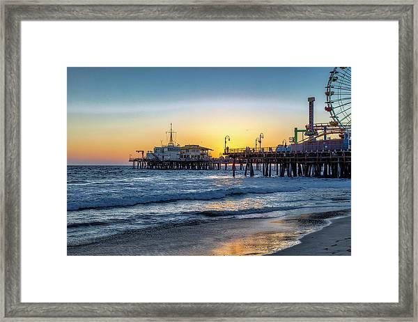 Sunset Under The Pier Framed Print