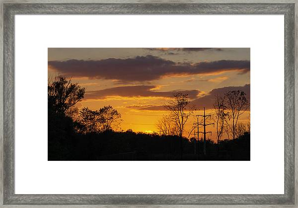 Sunset With Electricity Pylon Framed Print