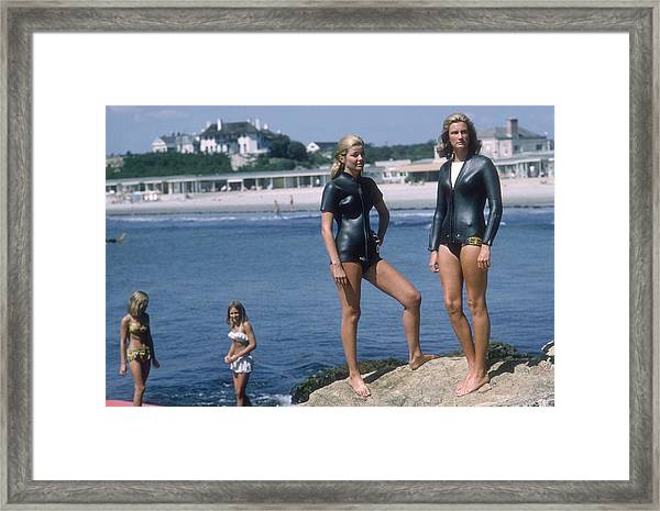 Swimmers At Newport Framed Print by Slim Aarons