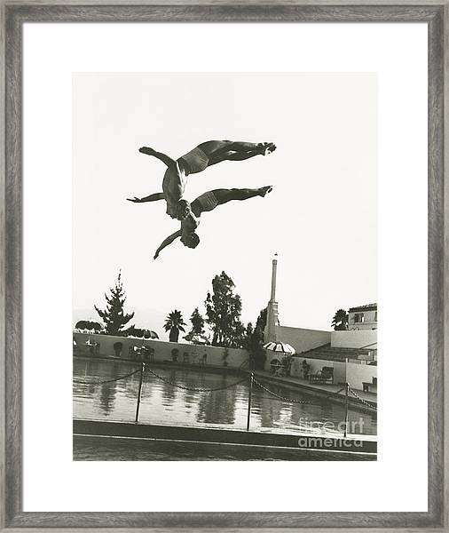 Synchronized Divers In Mid-air Framed Print