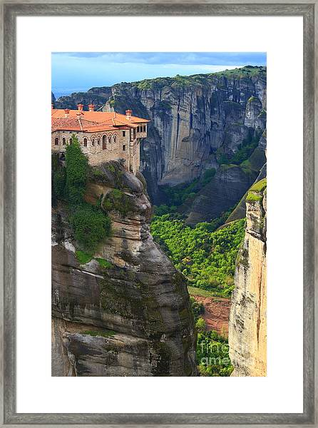 Tall Rock Pillars And The Holly Framed Print