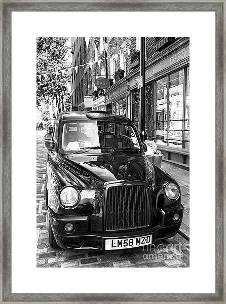 Taxi In The West End Of London Framed Print