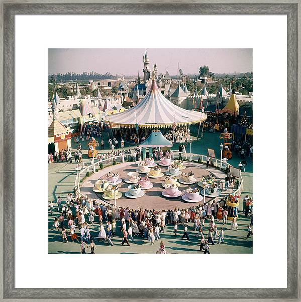 Teacups At Disneyland Framed Print by Loomis Dean
