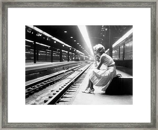 Teenage Girl Waiting For Train Framed Print