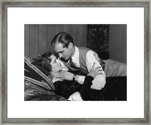 Tempting Kiss Framed Print by Sasha