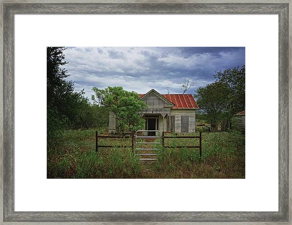Texas Farmhouse In Storm Clouds Framed Print