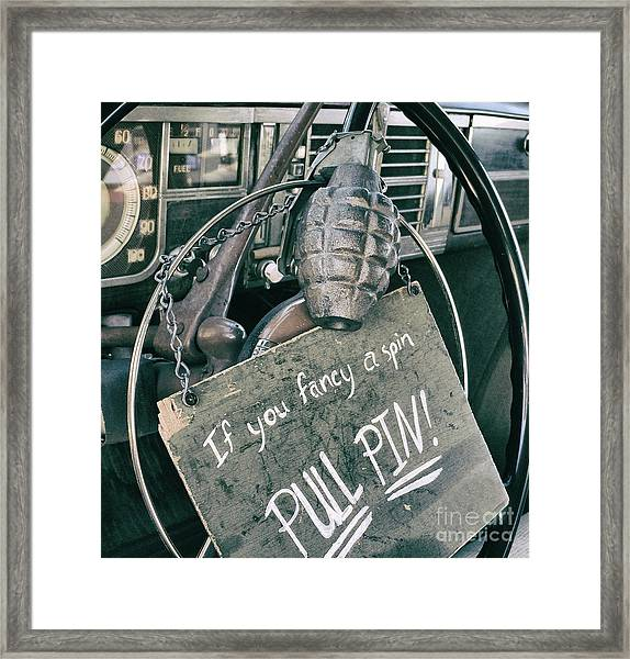 The Art Of Pulling Pins Framed Print by Steven Digman