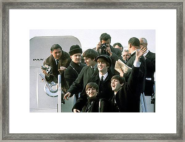 The Beatles Are Coming Framed Print