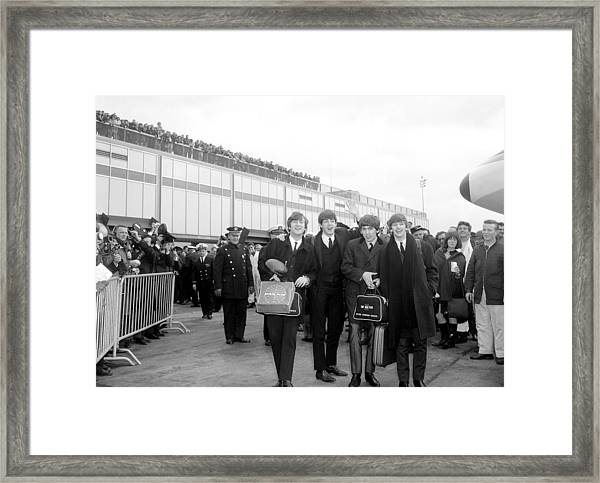 The Beatles Arrive At Kennedy Airport Framed Print