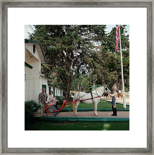 The Collins Framed Print by Slim Aarons