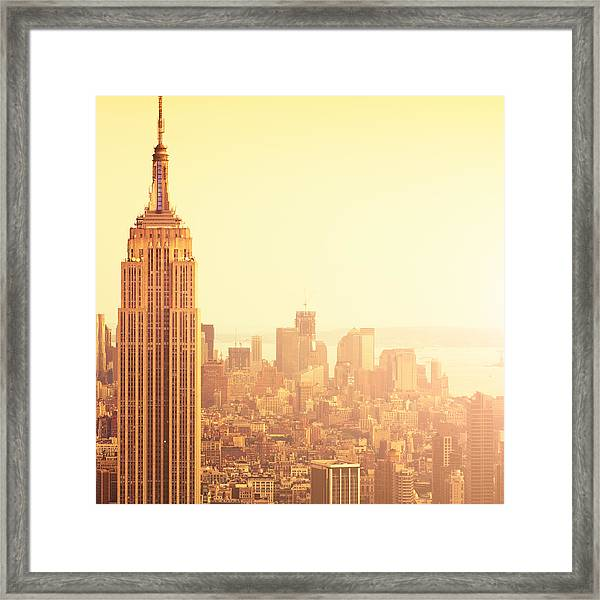 The Empire State Building In Nyc At Framed Print