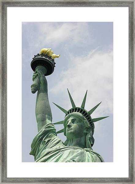 The Flame Of Liberty Is Held High Framed Print