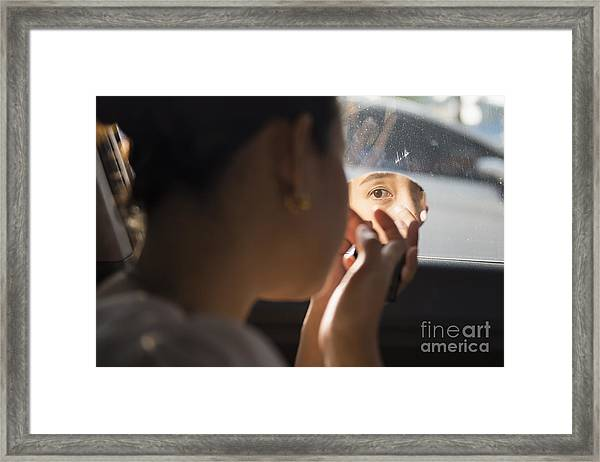 The Girl Is Doing Makeup In The Car Framed Print by Nattapan72